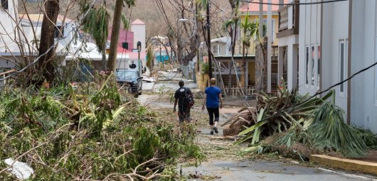 Cruz Bay, St John, US Virgin Islands - Sept 08, 2017: Aftermath of Hurricane Irma, St John, People walking past recently cleared hurricane destruction in downtown Cruz Bay, 2 days after storm. Irma was a devastating cat 5 hurricane that hit St John with sustained winds of 185 mph and gusts well above 200 mph