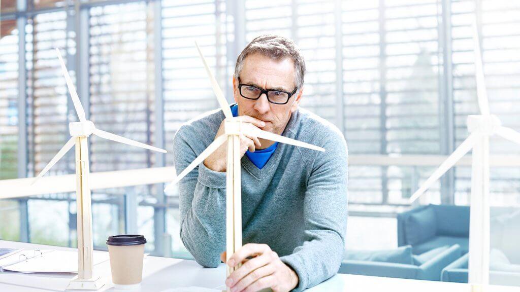 Designer thinking about sustainable energy ideas.